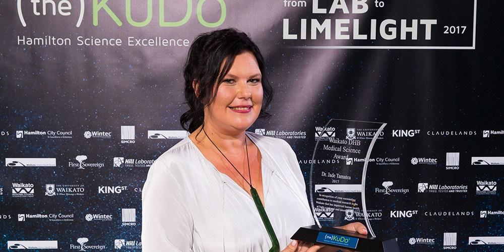 Jade Tamatea holding her award